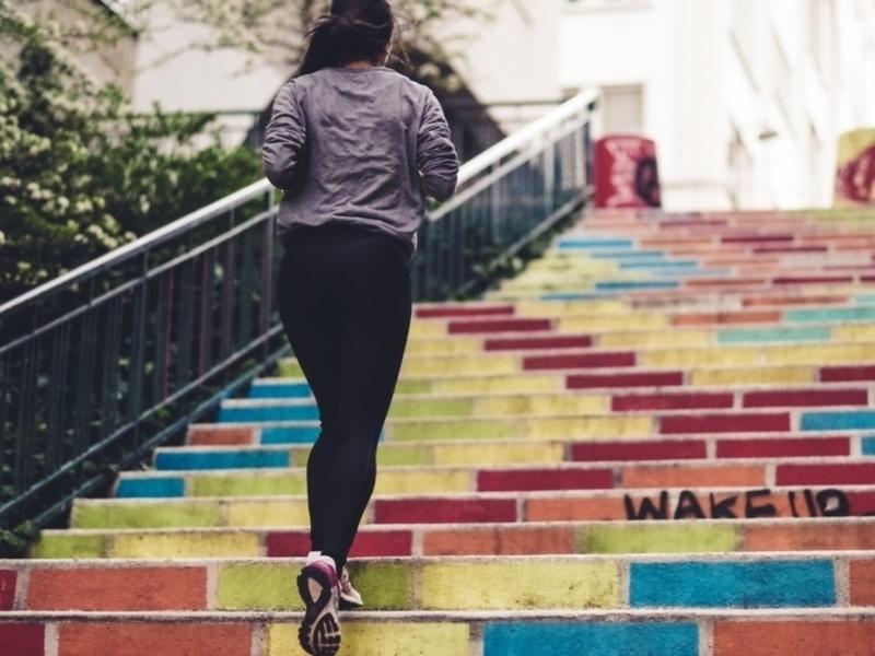 woman running up steps