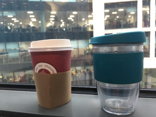 A single use cup and a reusable cup