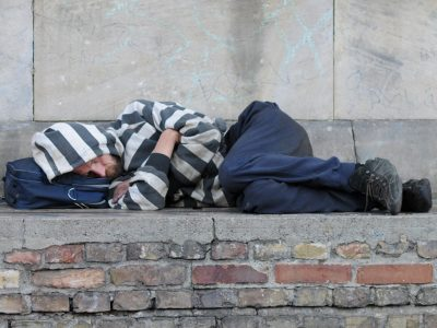 Man sleeping rough on steps