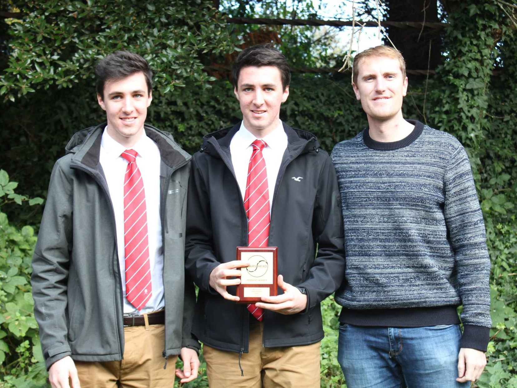 The brothers receive their prize from Olympian George Nash