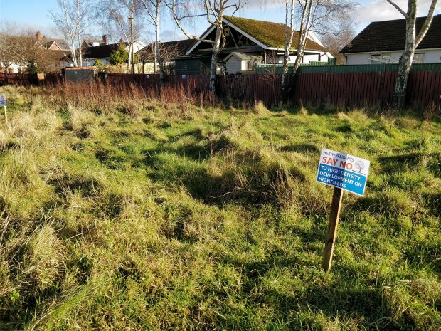 Placards have been erected on the former Highfields site objecting to the new homes development.