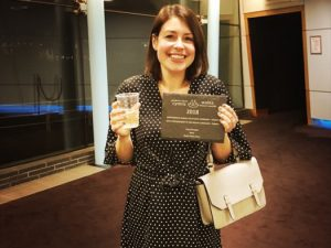 Actress Caryl Morgan holding her award for Best Actress in the Welsh Language