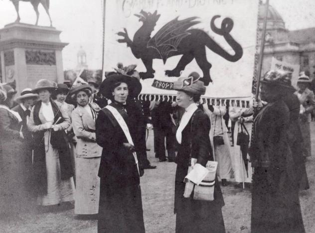 Woman Suffragettes in Cardiff with the Welsh flag in the background