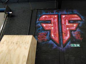 Fluidity Logo painted on the inside of the gym. Photo: Tasmin Lockwood