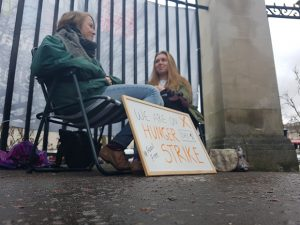 Two campaigners begin their hunger strike to persuade Cardiff University to stop investing in the fossil fuel industry.