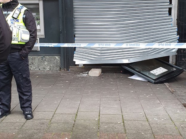 The Co-Op's entrance following the robbery.